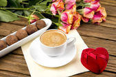 Cup of coffee on a wooden table, chocolate truffle — Stock Photo