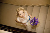 Wedding, Beautiful bride with bouquet of flowers — Stock Photo