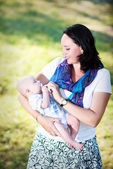 Beautiful young mother with a child in nature. — Stock Photo