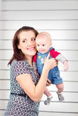 Picture of happy mother with adorable baby — Stock Photo