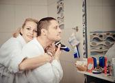 Man shaving electric razor — Stock Photo
