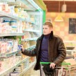 Young man shopping for groceries — Stock Photo