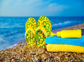 Things for the beach towel, sunscreen, flip flops — Stock Photo