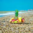 Fresh fruit on the beach — Stock Photo
