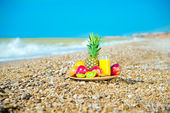Fresh fruit on the beach — Stock Photo