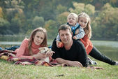 Happy large family with children in autumn park — Stock Photo
