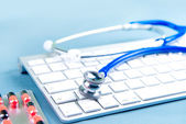 Stethoscope on laptop keyboard. Medicine concept — Foto Stock