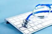 Stethoscope on laptop keyboard. Medicine concept — Foto de Stock