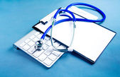 Stethoscope on laptop keyboard. Medicine concept — ストック写真