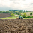 Agricultural work, tractor in a field — Foto Stock