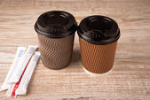 Coffee in a paper cup — Photo