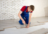 Young handsome men laid laminate floor covering, perform repairs — Photo