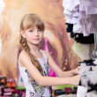 Pretty beautiful girl chooses clothes in shop — Stock Photo #49384913