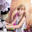 Pretty beautiful girl chooses clothes in shop — Stock Photo #49384943