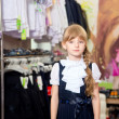 Pretty beautiful girl chooses clothes in shop — Stock Photo #49385117