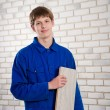 Builder with the floorboard — Stock Photo #49386049