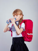 Girl drinking water from a plastic bottle — Stock Photo