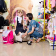 Woman with a child to buy clothes in shop — Stock Photo #49954131