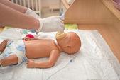 Newborn resuscitation on a mannequin — Stock Photo