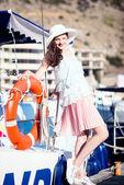 Young beautiful girl walking along the waterfront yacht club — Stock Photo