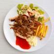 Stock Photo: Grilled pork steak with potato and salad