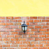 Lantern for light on brick wall — Stock Photo