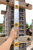 Spirit level using or home construction — Stock Photo