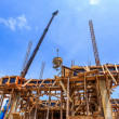 Crane working in construction on blue sky — Stock Photo