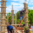 Labor building cement pillar for home construction — Foto Stock