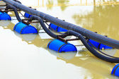 Pipe with Buoy in river — Stock Photo