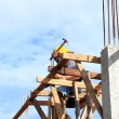 Labor prepare wooden timber for new house building — Stock Photo