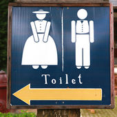 Man and woman wooden toilet sign — Stock Photo