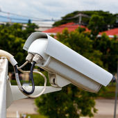White cctv camera watching for security factory — Stock Photo