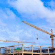 Crane working on construction site — Stock Photo