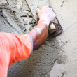 Plasterer concrete worker at wall of house construction  — Stock Photo #36539851