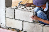 Brick wall construction for house building — Stock Photo
