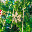 Christmas toy on green pine tree — Stock Photo