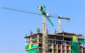 Construction site with crane and workers — Stock Photo