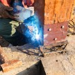 Welding metal and wood by electrode with bright electric arc — Stock Photo #38826981