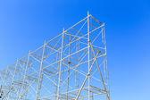 Scaffolding on blue sky — Stock Photo