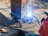 Welding metal and wood by electrode with bright electric arc — Stock Photo