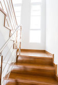 Interior wooden staircase of new house — Stock Photo