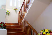 Interior wooden staircase with flower of new house  — Stockfoto