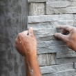 Worker install stone wall surface with cement for house — Stock Photo #45477477