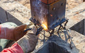 Welding metal and wood by electrode with bright electric arc  — 图库照片