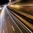 Long light trails from cars on a modern freeway — Stock Photo