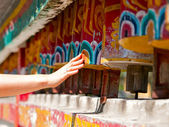 Female hand spinning the prayer wheels for good karma — Stock Photo