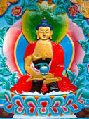 Schöne buddhistischen kunstwerke an der wand eines tempels — Stockfoto