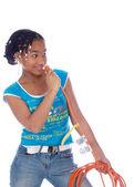 Chica joven poniendo powercable en la nariz — Foto de Stock
