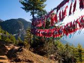 View of the Taktshang monastery in Paro with prayer flags — Stock Photo